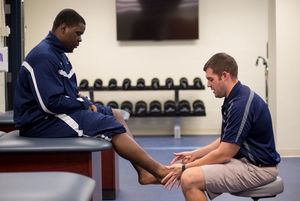 Chesapeake College Athletic Trainer Nick Williams, right, works with Skipjack men's basketball player Kamron Hall during a treatment session. Hall credited Williams' work with helping him return for the 2015-16 season. Credit: Tom Miller